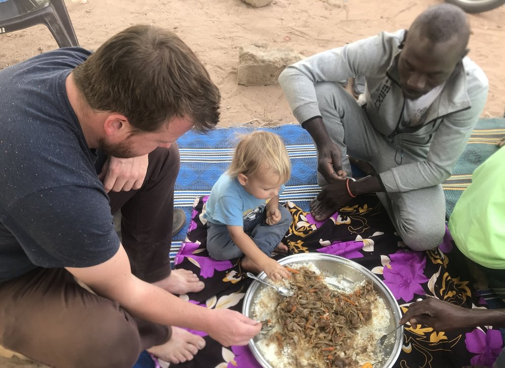One of our favorite experiences is enjoying a meal with friends and co-workers.  Here our son is learning how to eat rice and fish Senegalese-style.