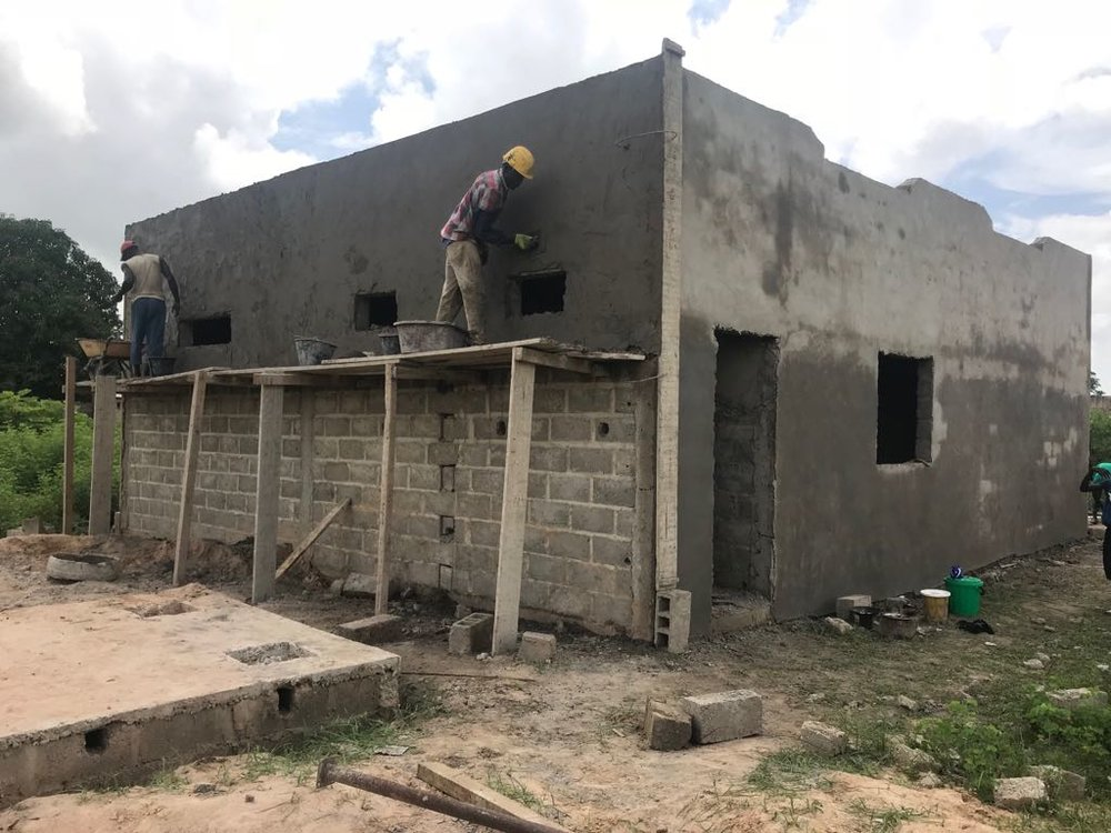 Finishing the exterior of the Batara Wolof health post.