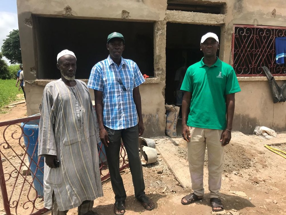 Outside the health post in Keur Ngor with the village Chief (left), Boubou, Andando Country Director (center) and Camara, Keur Soce Program Manager (right).