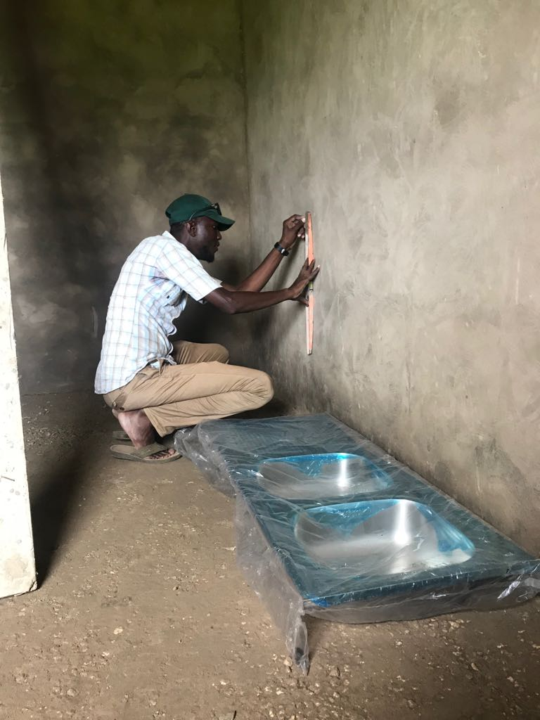 Installing plumbing and sinks at Keur Ngor health post.