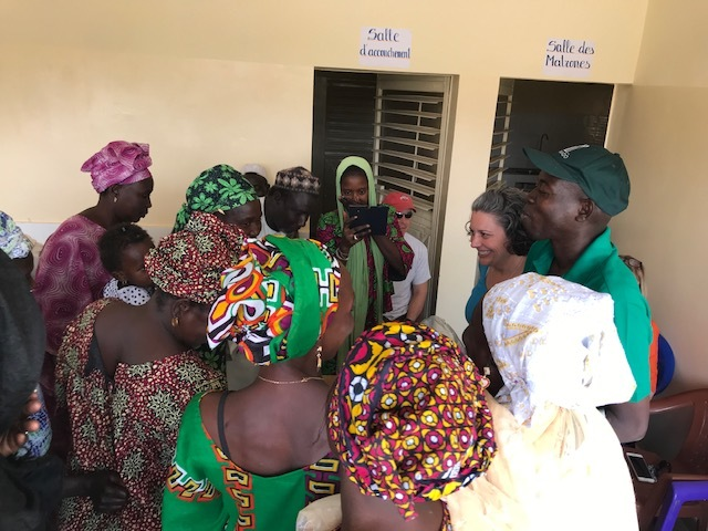 Midwives receiving a distribution of medical supplies.