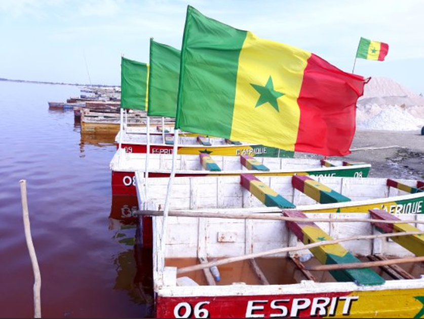 Boats flying the Senegal flag on Lac Rose (Pink Lake).