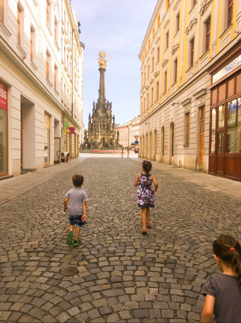 This kids running toward the city square