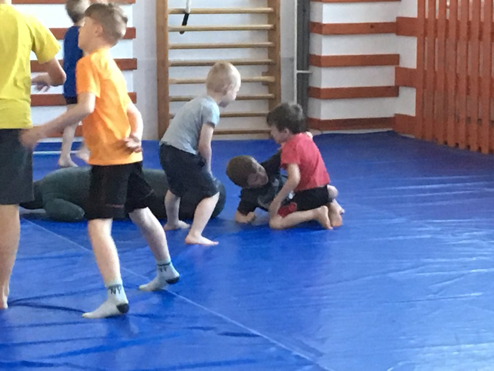 Andrew wrestling with the boys in Muey Thai before their lesson.