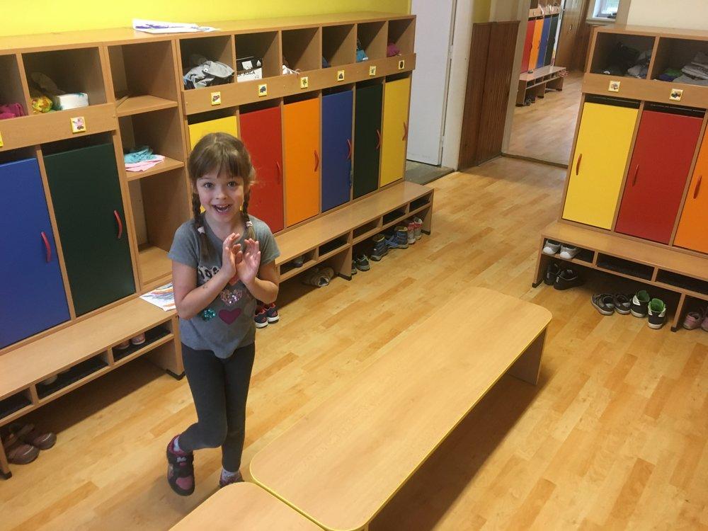 Nora getting ready at her školka/kindergarden