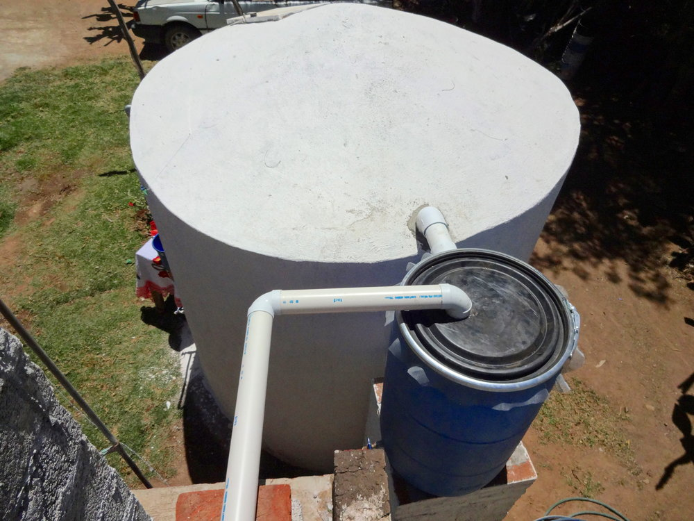 "A rainwater harvesting cistern with the new and improved ""first flush"" system design"