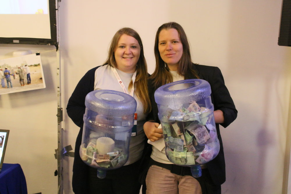 Sarah and Daniela with two of the donation-filled carboys after the event.