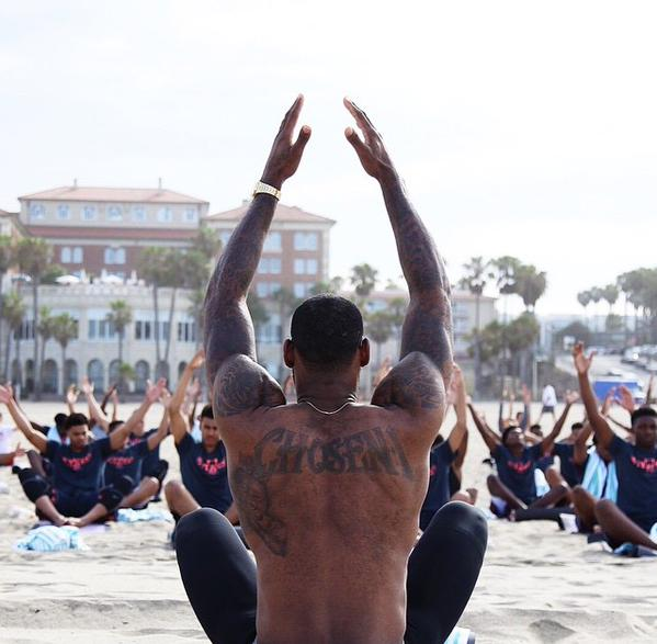 LBJ leading Yoga at a Nike Basketball Camp.