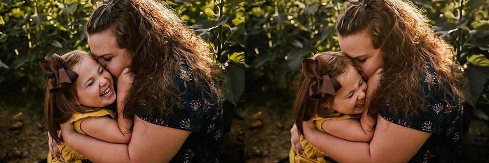 Rutherford-family-cleveland-photographer-lauren-grayson-sunflower-field-session_0015.jpg