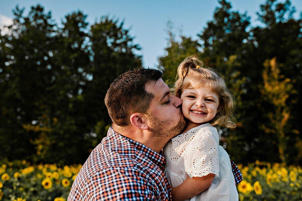 Rutherford-family-cleveland-photographer-lauren-grayson-sunflower-field-session_0029.jpg