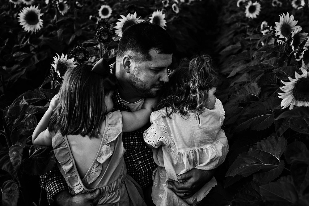Rutherford-family-cleveland-photographer-lauren-grayson-sunflower-field-session_0033.jpg