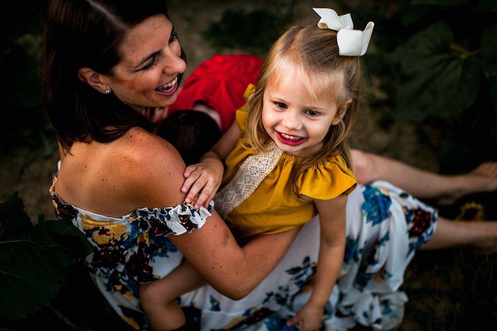 lauren-grayson-photography-cleveland-ohio-photographer-sunflower-fields-sunset-golden-hour-photo-shoot-mommy-and-me-family-child-photographer_0578.jpg