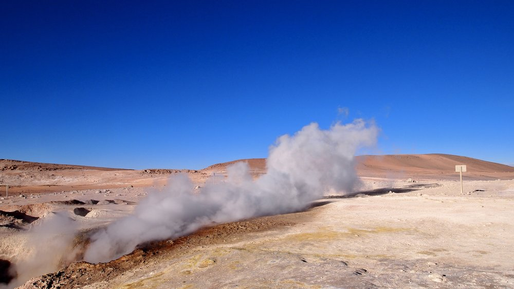 The steam pouring from the fumaroles' over 100 degrees celsius ( Sol de Mañana volcano, Sur Lípez Province, Potosi, Bolivia).
