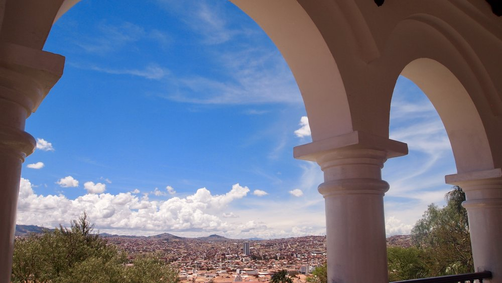 Sucre through the arches of Monastery de la Recoleta ( Calle Polanco, Sucre, Bolivia )