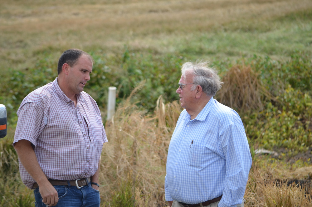 Jim Whitaker  and my dad discussing farming
