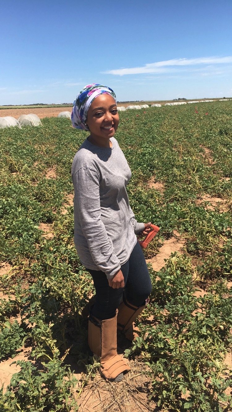 Zahra in the AgriLife research plots at West Texas A&M University.