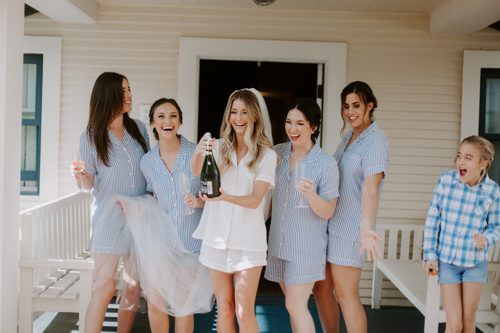 4. Bust out the Bubblies - Everyone loves a good toast, and this is your chance to thank all your bridesmaids for all the help they've done! This is a great time to hand out any bridesmaid gifts you may have gotten for them as well! Plus popping a champagne bottle makes for some great photos ops!