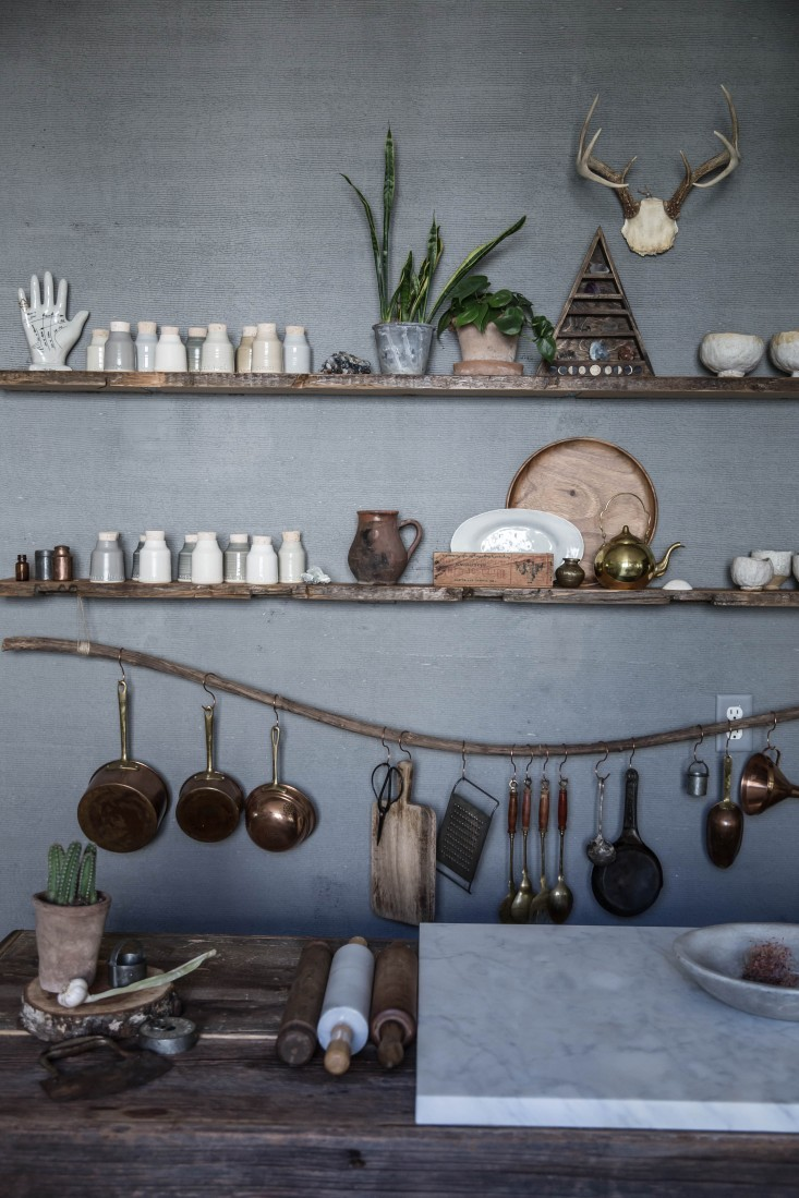 Both beautiful and practical; a branch of driftwood acts as a utensil rail for Beth's most-used tools.