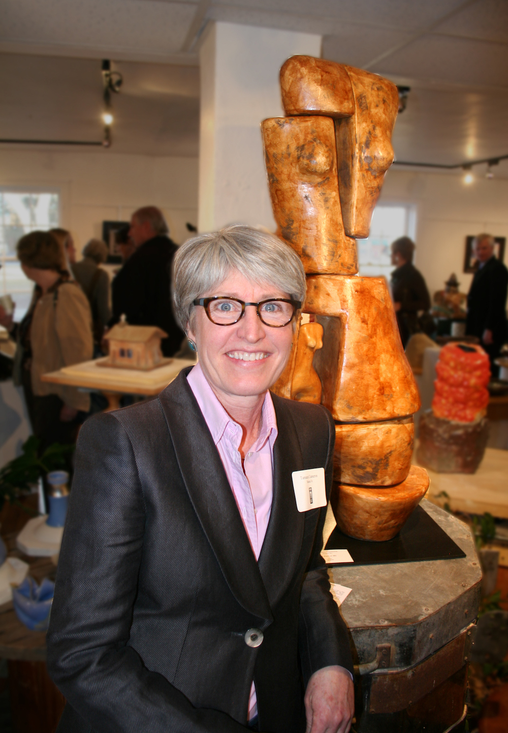 Tamara Cameron at a Fuller Lodge Art Center Opening standing in front of A Part of Me, 39x20x11, $2400