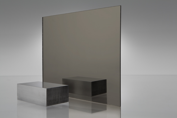 Bronze Coloured Acrylic Mirror ( http://www.plaskolite.com/ProductCatalog/FABBACK-Colored-Acrylic-Mirror )