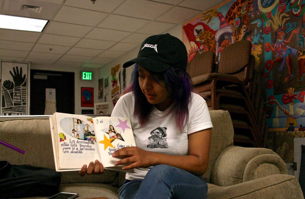 "Reeb Menjivar shows a book her mother handmade for her at Arizona State University in Tempe, Ariz. on April 15, 2016. ""With my own culture, I think it's kind of unknown because it's not like the majority or anything like that,"" she said. ""So we're always categorized as like Hispanic, we're always grouped into one thing but we're all so different. There are so many different cultures. People don't take the time to even try to understand that we all have different cultures and traditions. A lot again with the erasure of people's existence."""