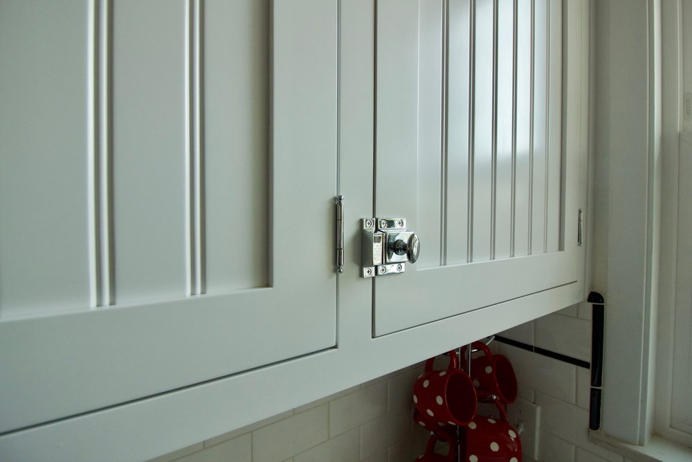 Inset face frame, flush fit drawers, and latches