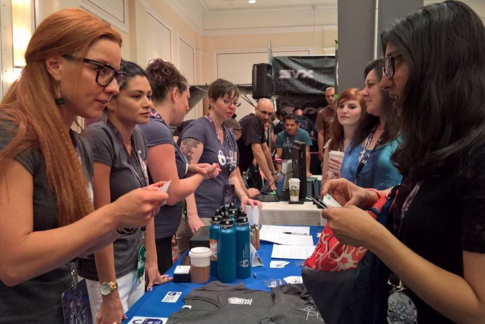 WISP DEF CON 24 Vendor Booth : Co-Founders & Board Members Elena Elkina, Kenesa Ahmad & Debra J. Farber and WISP Publications volunteer, Samantha Cowan, discuss WISP with attendees.