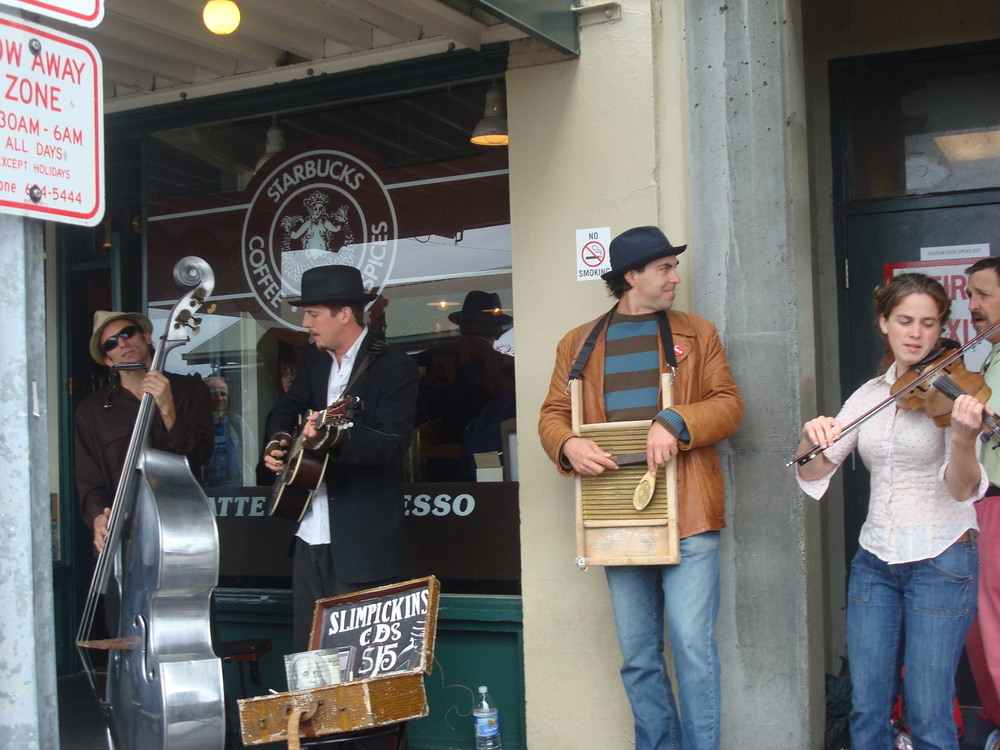 A band jams in front of the very first Starbucks. The company later expanded…