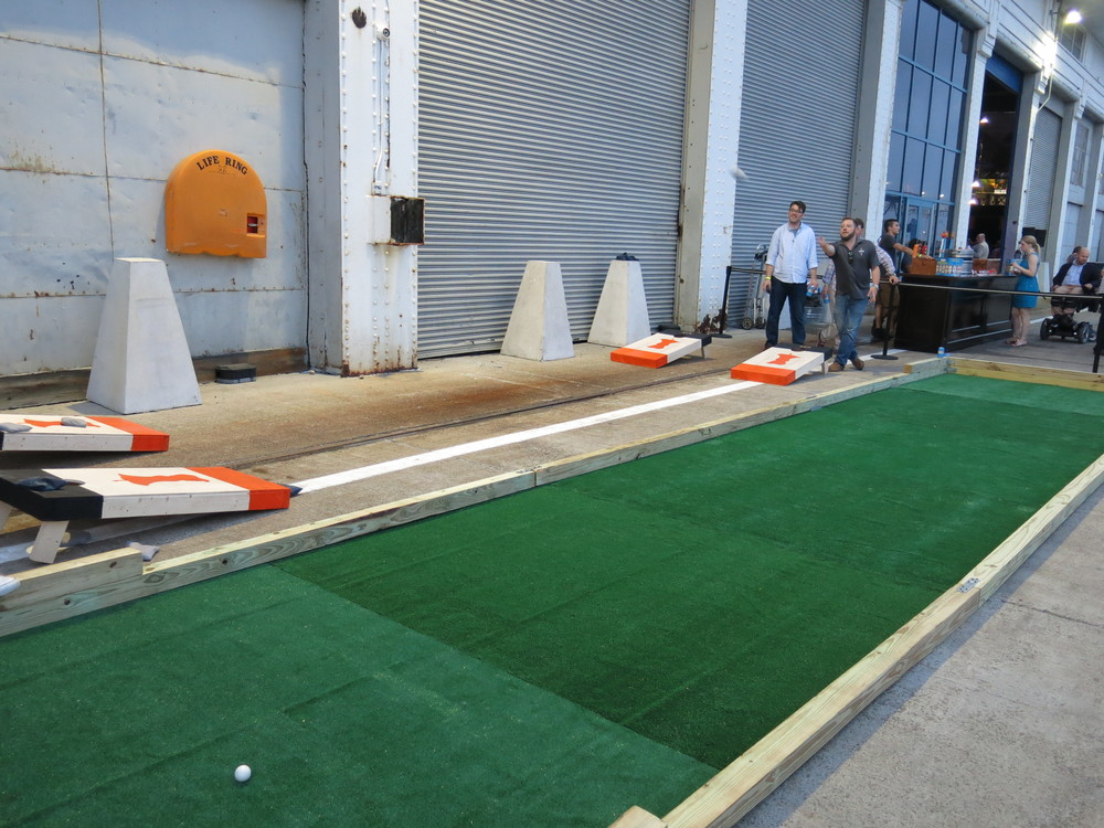 Work off your dinner with a little cornhole.