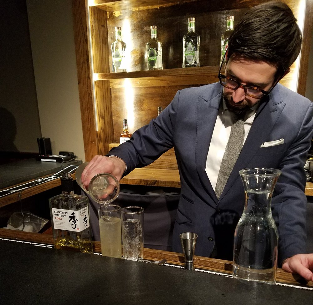Thirst co-organizer Nick Korn pours a Toki Highball at the Friday night opening party.