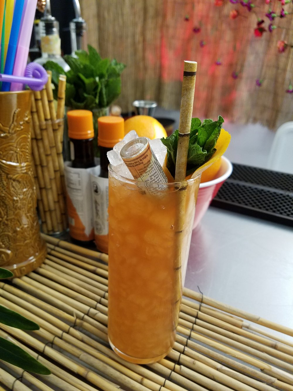 Another beauty from State Lines. The Smugtown Swizzle, made with Angostura white oak rum, Amaro di Angostura, spiced coffee demerara, lime, and a whole mini-bottle of orange bitters.