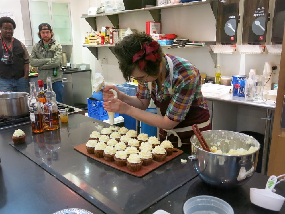 Pastry chef and bartender Kate Holowchik whips up carrot cake cupcakes with Mount Gay rum buttercream frosting in a seminar on making boozy pastries.