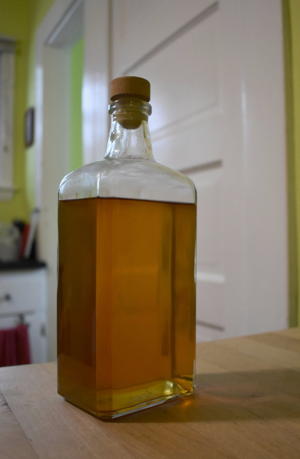 My homemade orange liqueur looks sharp in this former bottle of Mythic Gin.