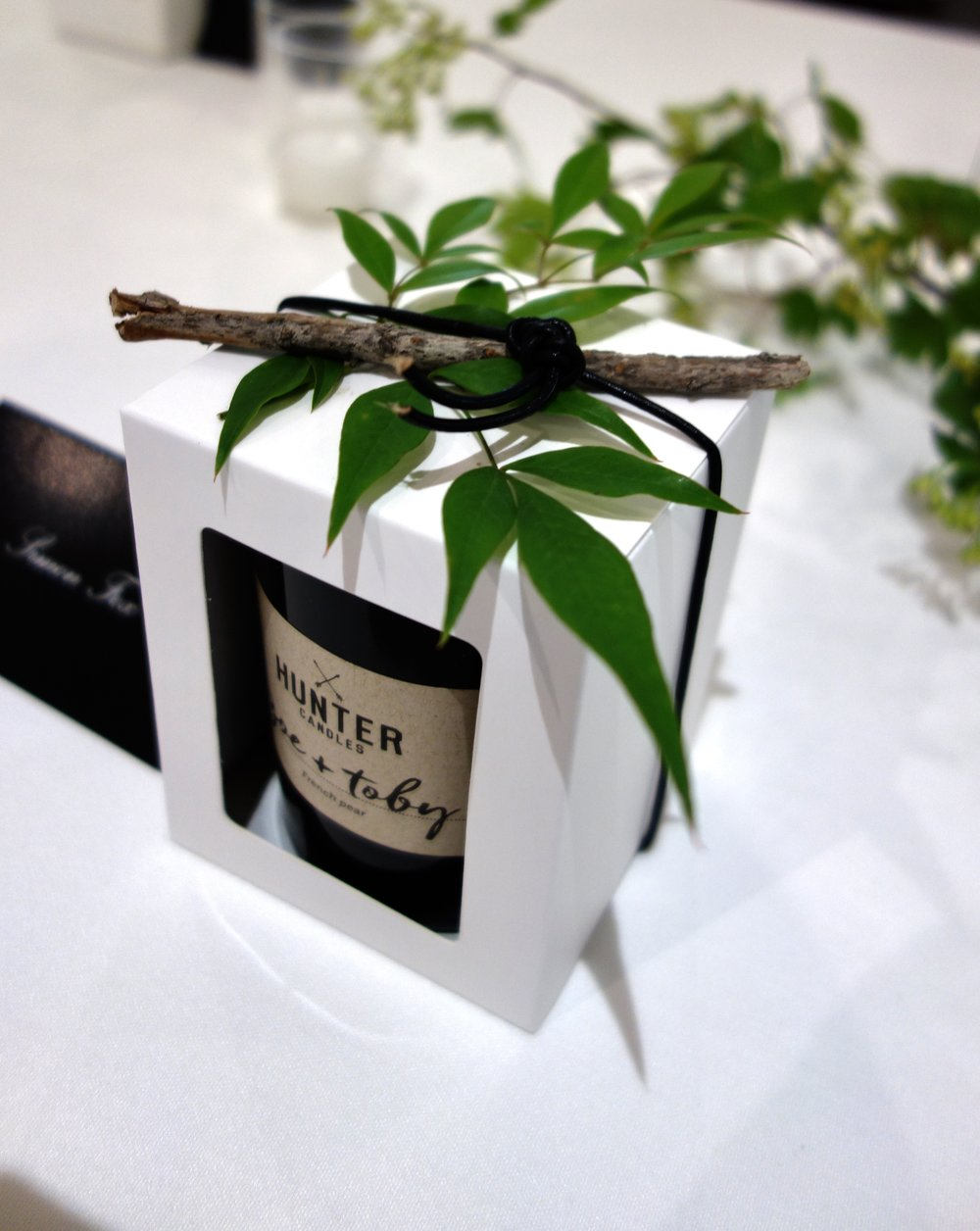 Bespoke Hunter Candles packaging with leaves and twig