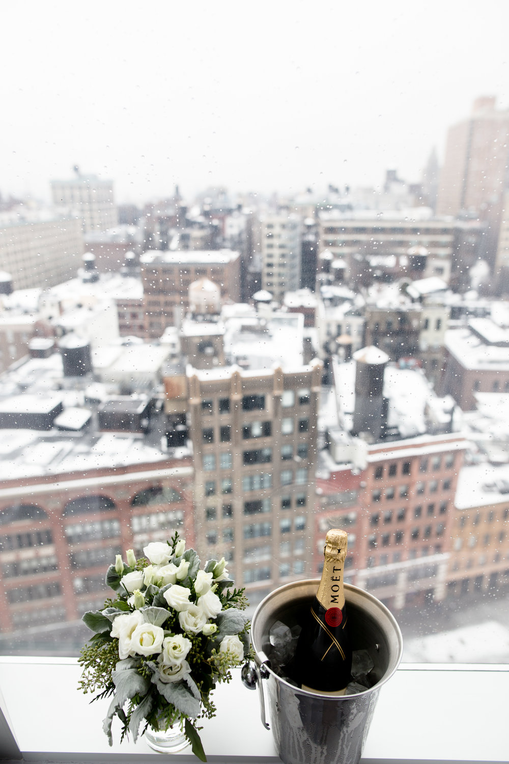 My brother got married in the greatest city on earth just before Christmas. There was just enough snow on the ground to make everything romantic, without delaying guests from getting to the lower east side locale on time. There's truly nothing like a winter white wedding in New York City.
