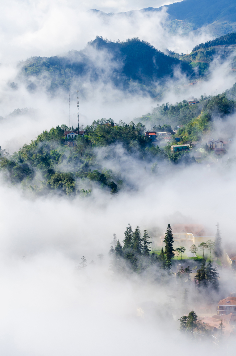 Sapa valley city in the mist in the morning...