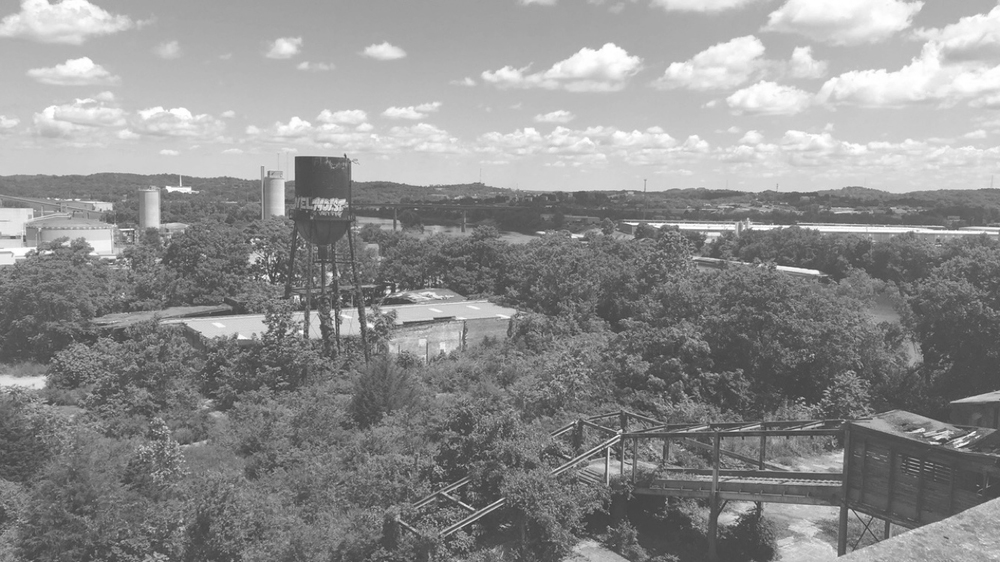 view of existing north site conditions + cumberland river + water tower, photographed from slaughterhouse roof