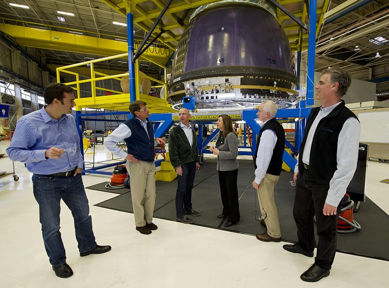 NASA Deputy Administrator Lori Garver, fourth from left meets Blue Origin Founder Jeff Bezos next to Blue Origin's crew capsule along with other Blue Origin team members at the company's headquarters in Kent, WA.  Image by Bill Ingalls via Wikimedia Commons