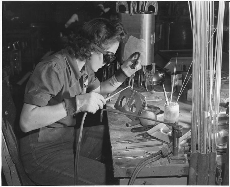 1942: A female welder works on a sub-assembly for a tank used on B-25 bombers. Image via  Wikimedia Commons
