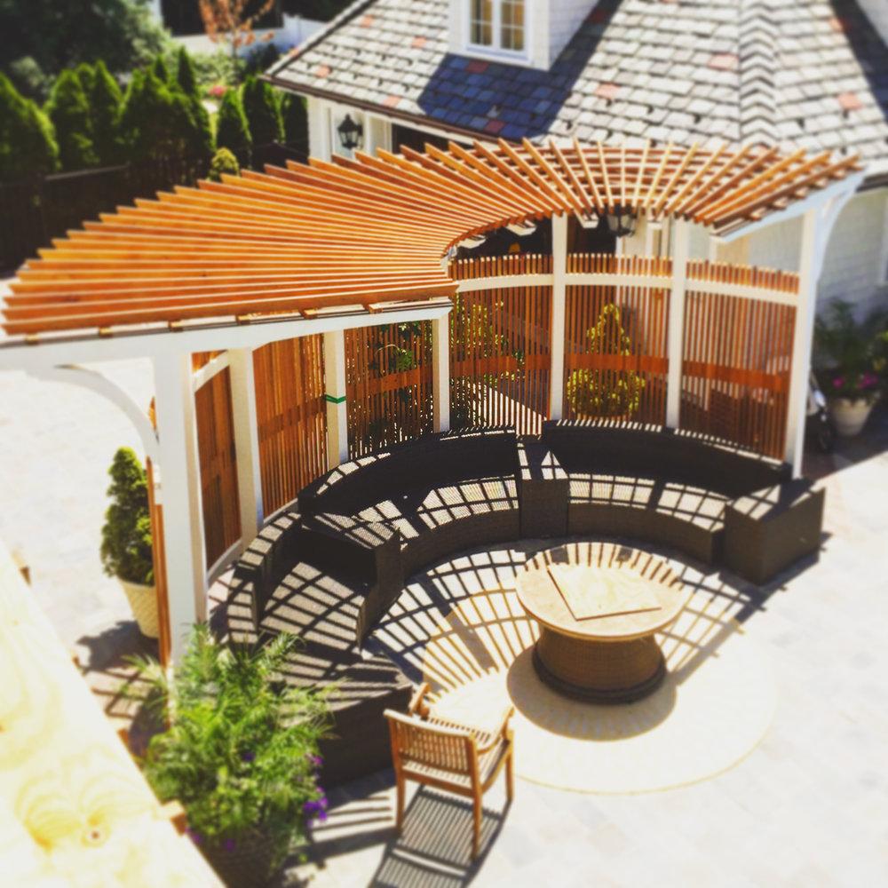 pool side curved custom designed cedar pergula