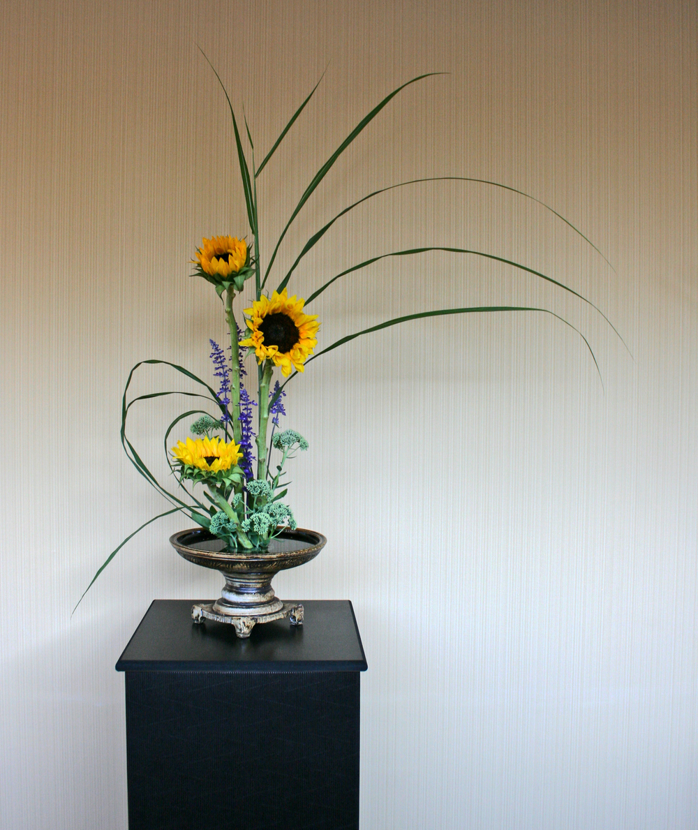 Container + Flowers by Sue Grier