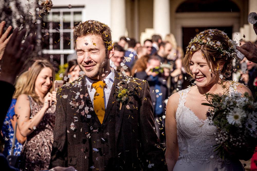 colour confetti bride and groom portrait