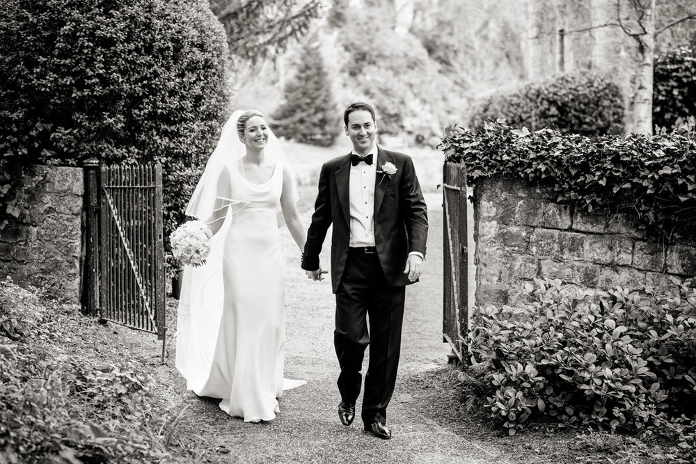 Bride and groom walking at the Turkey Mill in Kent