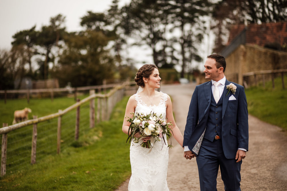 Kingscote Barn bride and groom