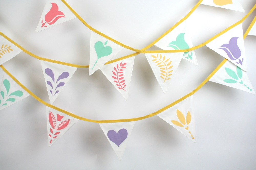 10 metres and 12 metres hand sewn and hand screen printed triangular bunting:   Flags measure 18.5 cm wide x 21 cm high  Flags are double sided, with yellow tape.   HIRE:   £3.50 per metre  BUY:   £12 per metre