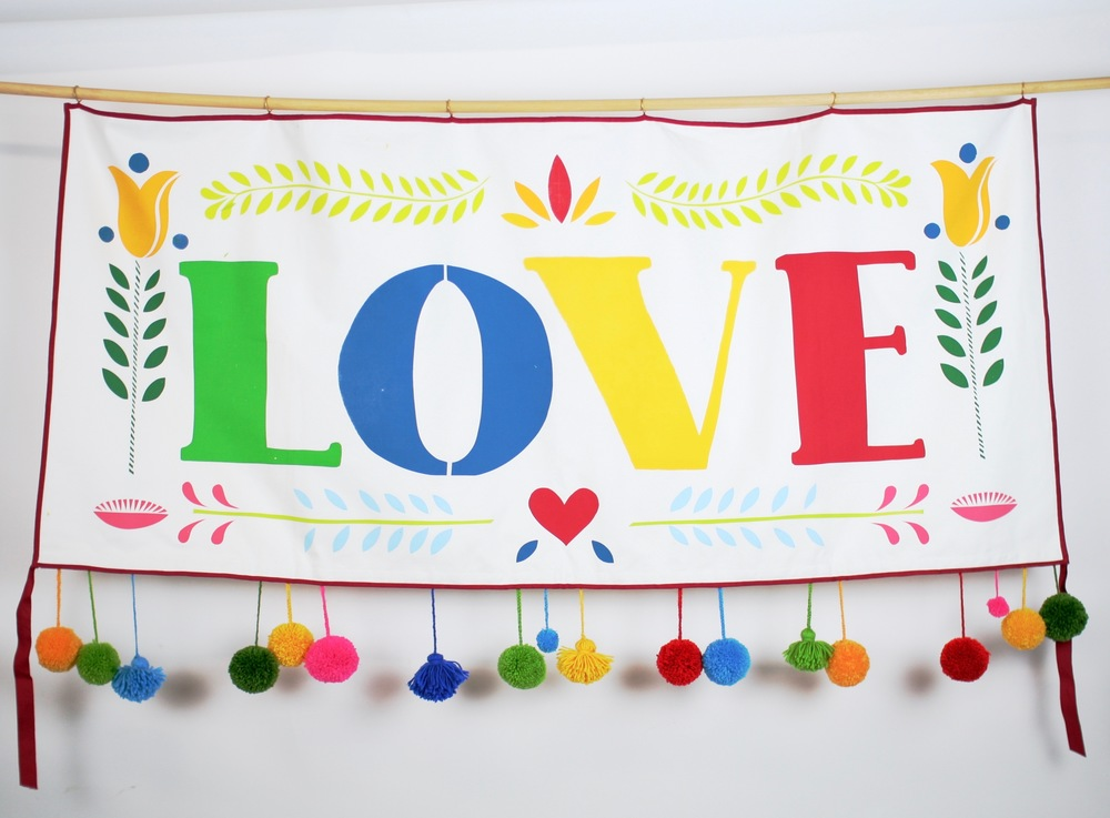 Hand screen printed banner measures 152 cm x 69 cm  The banner is backed with the same soft brushed cotton as the front and each banner has six brass rings for hanging. Trimmed with red twill ribbon. With optional pompoms and tassel trim!   HIRE:   £50/£75 with trim   BUY:   £200 without trim / £300 with trim  BESPOKE:   Prices from £250