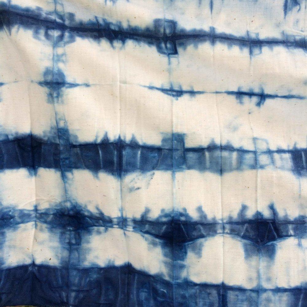 indigo shibori folding.jpg