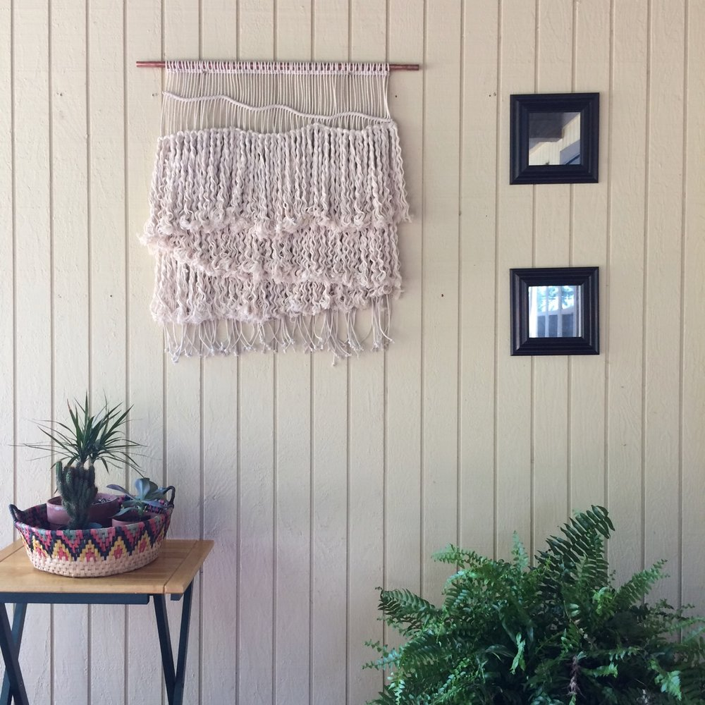 outdoor macrame wall hanging