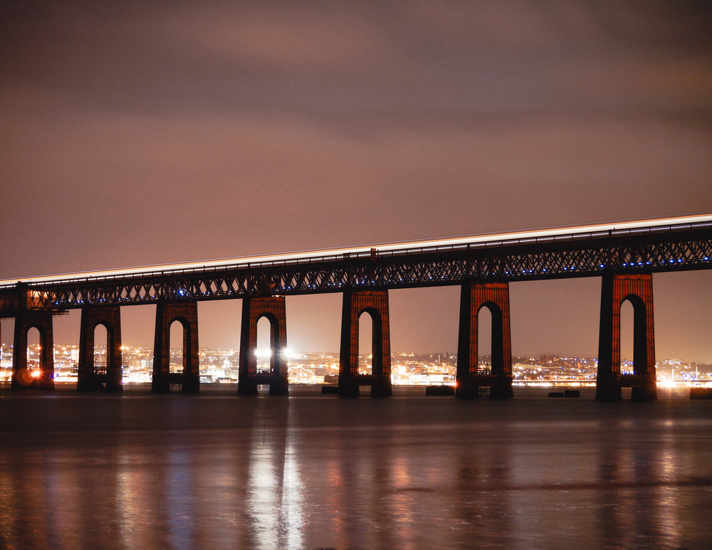 Train crossing the Tay at night.