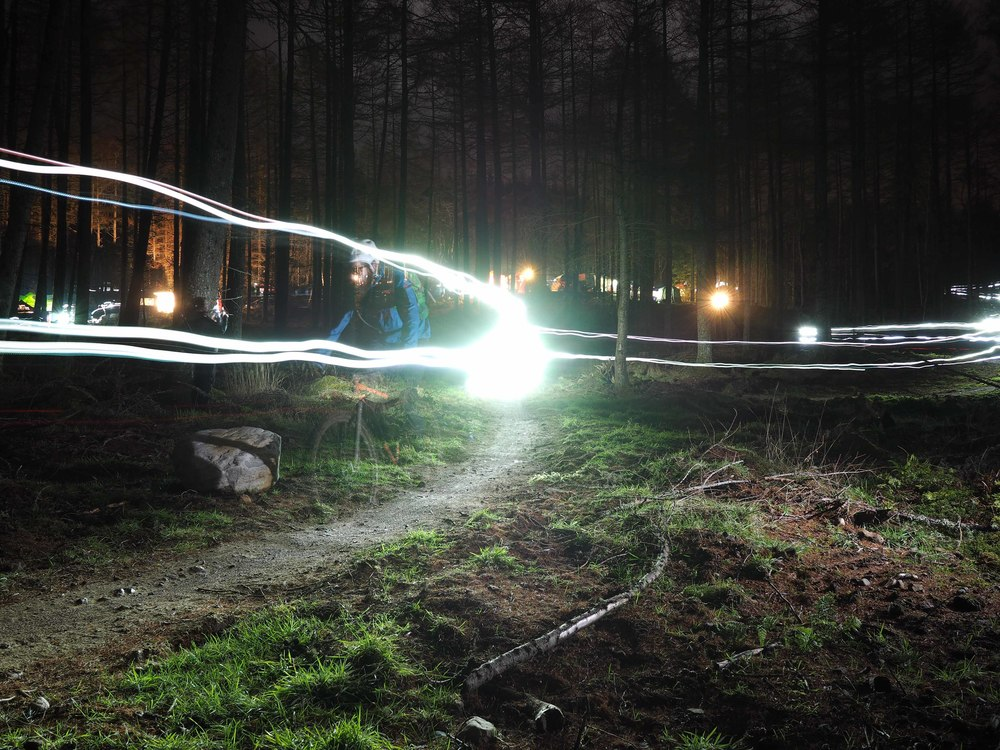 Strathpuffer 24hr mountain bike racers light up the forest in the middle of the night.